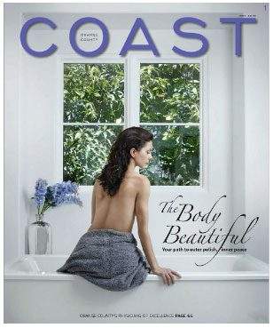 Coast Magazine Cover woman sitting on bath with back to camera